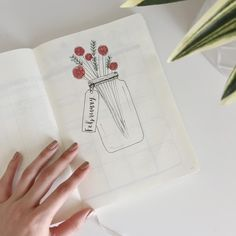 Bullet journal monthly cover page, February cover page, flowers in a vase drawing, Valentine's Day bullet journal drawing. | @bujowithmel