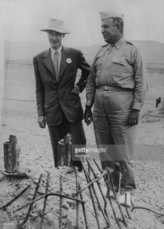 Nuclear physicist Julius Robert Oppenheimer (1904 - 1967), left, with Major General Leslie Groves, by the remains of the tower from which an atom test bomb was ignited, at Los Alamos, California.