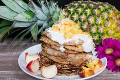 Looking for a nice and healthy Sunday breakfast? Then these vegan pineapple buckwheat pancakes with coconut cream and peaches might be perfect for you!