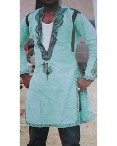 African Men casual shirt AMCS057    AFRICAN ATTIRE ONLINE :THE ONLINE SHOP FOR AFRICAN FASHION AND ACCESSORIES     African Attire Casual Shirt  African Linen  fitted shirt with bold and  exquisite embroidery     Unique design for celebrity       comfortable, breathable fabric   Casual: Top only   Fabric : Italian Linen  Colour: Black thread embroidery on green Italian Linen   Sex: Male
