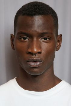 Model Adonis Bosso poses backstage at the Maria Ke Fisherman fashion show at The Standard Hotel on September 2014 in New York City. Adonis Bosso, Dark Skin Models, Black Male Models, Facial Aesthetics, Hair To One Side, Handsome Black Men, Face Men, Face Photo, Crew Cuts