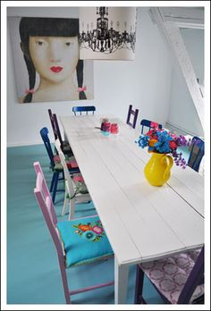 Blue floor, and the mismatched chairs! Love.
