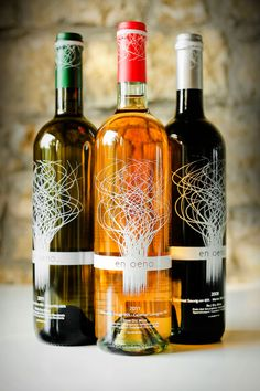 """""""En Oeno..."""" references Ancient Greek proverb """"En Oeno Alethea,"""" which means """"In wine, there is truth."""" Since ancient times, Greek wine consumption has led to the revelation of secret verities locked mysteriously inside one's self."""""""