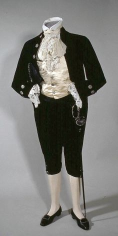 Men's Court Suit, c. The tailcoat and knee breeches are in dark blue velvet, with white satin waistcoat - all are cut with steel buttons. Under the right arm is a folding dress hat in black plush and on the other side, a sword. Historical Costume, Historical Clothing, 1890s Fashion, Vintage Fashion, Dress Hats, Dress Up, Fancy Dress, Vintage Outfits, Vintage Clothing