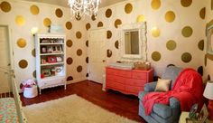 Gold Polka Dot Walls in this Coral and Gold Nursery