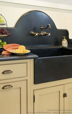 #Kitchen Idea of the Day: A vintage in-wall faucet, a shaped slab backsplash, and beautiful inset cabinets. See our kitchen backsplash guide. (By Crown Point Cabinetry)