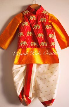 Ikkat jacket with elephant motifs all over. Paired with rawsilk kurta and silk dhoti.To order pls watsapp or call on 08 January 2019 Kids Dress Wear, Kids Gown, Dresses Kids Girl, Baby Dresses, Kids Indian Wear, Kids Ethnic Wear, Toddler Fashion, Kids Fashion, Kids Dress Collection