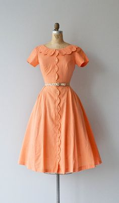 Ice Cream Social dress from DearGolden. Vintage 1950s tangerine cotton dress with scalloped collar and button placket, short sleeves, princess seaming, fitted waist, full skirt and plaid belt.