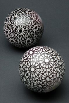 White Arabesque and Black Arabesque marbles by Mark Matthews