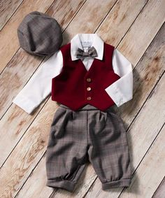 Take inspiration from the past with this charming vintage plaid vest and knicker pant set for toddler boys. Your little boy will be simply adorable when dressed up in this special occasion holiday outfit! Whether he's going to a party, dressing for photos, heading to church or to a wedding this festive knicker pant set is sure to be the perfect choice for all of your holiday season festivities!