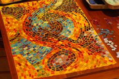 fabric mosaic - love it on the colored background.
