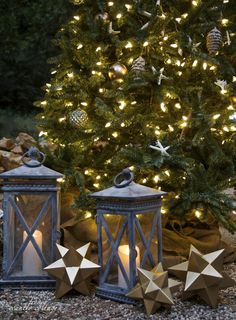 Large Candela Outdoor Lanterns scattered around the tree for added charm.