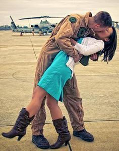 "must dot the famous ""kissing the war goodbye"" pose!"