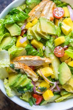 This Chicken Mango Avocado Salad recipe is loaded with juicy chicken, creamy avocado and that sweet pop of mango flavor takes this mango salad over the top. The sweet and tangy honey vinaigrette couldn't be easier! A Cheesecake Factory recipe (copycat). Mango Avocado Salad, Mango Salat, Avocado Dessert, Avocado Salad Recipes, Mango Recipes, Salad Dressing Recipes, Healthy Salad Recipes, Avocado Toast, Healthy Snacks