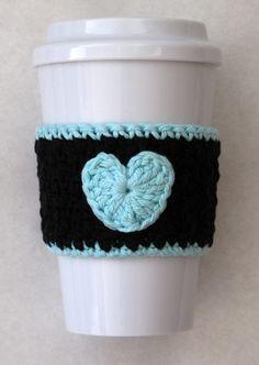 blue and black crochet heart coffee cozy