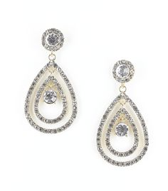 Add some serious glamour to your wardrobe with these stunners! A gold tone rhinestone encrusted double tear drop holds two large rhinestones for some major bling factor! Combine this pair with any of your little black dresses for some amped up appeal. 2 3/4 inch drop