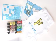 Easy personalised/customised baby clothing gift.  DIY stencilled baby grow using DecoArt alphabet stencils, Decoart SoSoft fabric paint and a onsie/vest from Tescos.