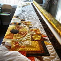 From Kathleen Quilts blog - really like her use of ribbon candy quilting!