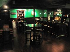 Joe's Basement Pub, We love the look and feel of an Irish Pub and decided to put one in our basement.  We built this space entirely from scratch.  Even the bar and backbar.  Its 600 sq feet and seats 27.  , View from the front entrance   , Basements Design