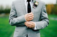 The Amsterdam wool light gray tuxedo is a two button suit, single breasted, with a side-vented back.