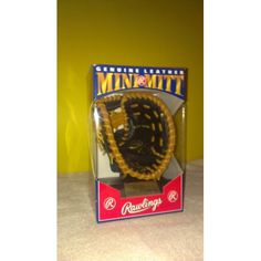 "1991 MARK McGWIRE Rawlings Genuine Leather MINI MITT with Stand in Original Box  1991 RAWLINGS GENUINE LEATHER MINI MITT ""HEART OF THE HIDE"" ""GOLD GLOVE""  MARK McGWIRE GLOVE COMES WITH STAND AND COLLECTIBLE BASEBALL CARD COMES IN ORIGINAL BOX (BOX SHOWS SOME SHELF WEAR)  BEAUTIFUL PIECE OF MEMORABILIA."