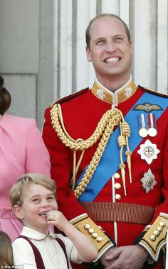 Better by smiles: William and George enjoy the RAF flypast over the palace