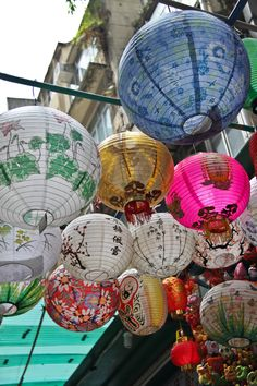 Lanterns in Hong Kong - I've got one such lantern as the ceiling light in my room: white paper printed with brown bamboo stalks.