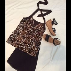 Leopard Halter Top Leopard Halter style Top. Very cute and comfy Made of stretchy material. Very figure flattering. I believe it's a poly blend. Brown, black and cream colors. Pairs well with skirts, shorts or pants. Love this top❤️‼️ Iz Byer Tops
