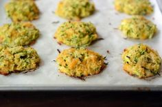 Healthy Baked Cheesy Zucchini Bites {i. Fritters}-Simple and delicious, these baked cheesy zucchini bites are so easy to make and are a healthier alternative to a classic fried zucchini fritter! Baked Zucchini Fritters, Zucchini Bites, Bake Zucchini, Fried Zucchini, Zucchini Pancakes, Vegetable Recipes, Vegetarian Recipes, Baby Food Recipes, Cooking Recipes
