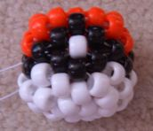 Crumpet's Kandi Patterns - How To Make A 3D Pokeball. I've made these for all my friends. It's not that hard and makes a really neat gift.