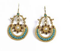These Etruscan-inspired earrings have been hand-linked in brass, turquoises and garnets with the proper passion of one of our metalsmith masters.