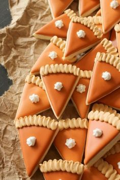 These cute mini pumpkin pie slice cookies are easy to snack on and will give your Thanksgiving dessert table some pizzazz. These cute mini pumpkin pie slice cookies are easy to snack on and will give your Thanksgiving dessert table some pizzazz. Thanksgiving Cookies, Fall Cookies, Thanksgiving Traditions, Thanksgiving Recipes, Fall Recipes, Holiday Recipes, Pumpkin Cookies, Iced Cookies, Thanksgiving Decorations
