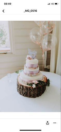 Easter themed wedding cake on wooden stand. Mini eggs to decorate.