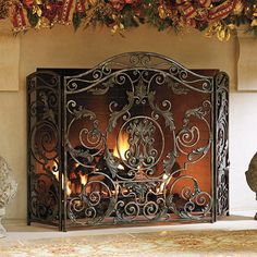 Whether the fire is lit or not, the head-turning Avignon Fireplace Screen makes your fireplace truly stand out. Classic, hand-forged iron scrolls are adorned with richly dimensional cast acanthus plumes and a warm pewter finish. Glass Fireplace Screen, Fireplace Screens, Fireplace Hearth, Fireplace Design, Fireplace Tools, Dream Furniture, Hearth And Home, Fireplace Remodel, Tuscan Decorating