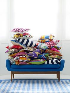 Team mixed-motif tribal print cushions for an electric African-inspired look.