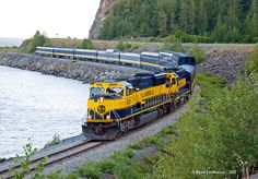 The July version of the Coastal Classic along the Turnagain Arm. One thing about all those mountains along the arm.they block the sun for some time here. Locomotive, Dazzle Camouflage, Alaska Railroad, Railroad Pictures, Abandoned Cars, Railroad Tracks, Lighthouse, Scenery, Stevie Ray
