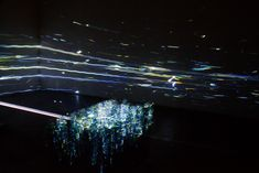 Created by Shohei Fujimoto, Power of One #Point is an installation exploring input and output using laser and reflecting mirrors.