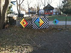 """Fence weaving - the act of weaving fabric strips into chain link fence. Related to the concept of """"yarn bombing"""" however it is less in yo f..."""