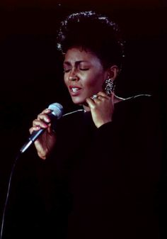 Anita Baker....her favorite color had to be black back in the day..lolz..always see her wearing it
