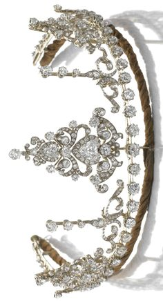 DIAMOND NECKLACE/ TIARA, CIRCA 1890  The diamond necklace designed as a graduated line of circular-cut diamonds to knife-edge linking, accompanied by seven jewels, the largest of acanthus and scroll design, articulated and set with circular-, single-cut, rose and triangular diamonds, the remaining six jewels of similar design, mounted in silver and gold. Accompanied by several fittings including a tiara frame, brooch, hair comb and pair of earrings, later fitted case.