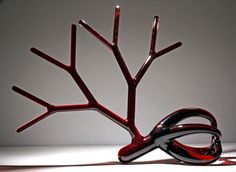 """Hand Blown Glass Wine Decanters Inspired By Arterial Blood Flow By Etienne Meneau Artist Etienne Meneau crafts the traditional wine decanters with an artistic twist - glass veins become red wine holders in his """"Stranger Carafes"""" series."""