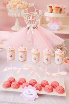 pretty in pink prima ballerina birthday party for grace ballerina forms covered in pink tulle tutus on dessert table