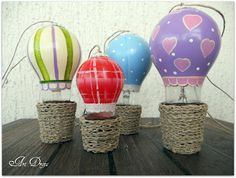 Art Drops: Lightbulbs made into Hot Air Balloons. Very Cute!