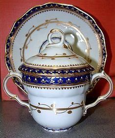 Antique Derby Chocolate Cup and Saucer, Bands of cobalt blue w/ gold gilt decoration on white ground, Puce Mark, circa 1790 -- Late century lidded covered English porcelain chocolate cup w/ handles and saucer