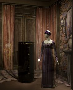 Paul Poiret, '1811' Evening Gown worn by Denise Poiret, 1907. Pink and purple striped silk and purple chiffon with gold lace trim.