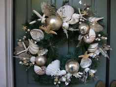 """As Seen Featured in Nov.2012 Romantic Homes Mag. """"Christmas By The Sea"""" Seashell wreath. $175.00, via Etsy."""