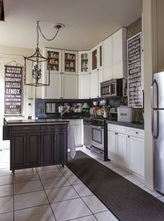 Valorie's Bold New Orleans Home/ like how she divided the cabinets in two instead of thirds or fourths...