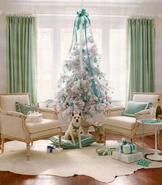 Decorating with aqua and pastels give this Christmas living room a elegant holiday look.
