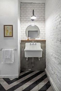 Black White Moroccan Floor Tile Bath/Remodelista - love the big floor pattern in a small space.