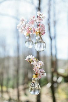 Pretty in pink flowers hung in little glass vases-- such a unique decor idea! {Keepsake Memories Photography}